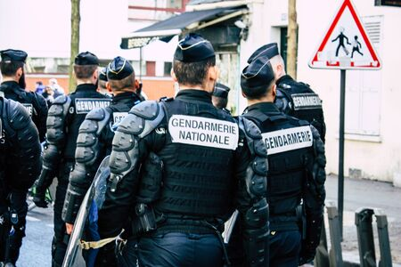 Paris France May 04, 2019 View of a riot squad of the French National Gendarmerie in intervention during protests of the Yellow Jackets against the policy of President Macron in Paris on saturday afternoon Banque d'images