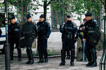Paris France May 11, 2019 View of a riot squad of the French National Police in intervention during protests of the Yellow Jackets against the policy of President Macron in Paris on saturday afternoon