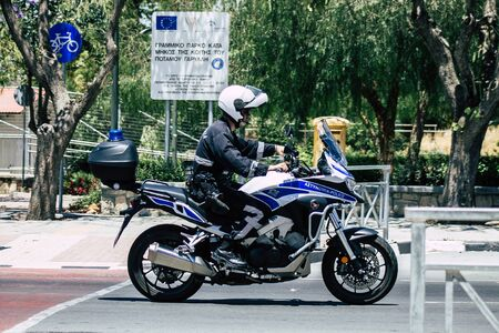 Limassol Cyprus May 26, 2020 View of a traditional Cypriot police officer with a motorcycle rolling in the streets of Limassol in Cyprus island