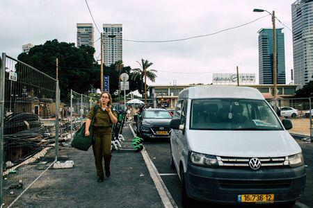 Tel Aviv Israel September 20, 2019 View of unknowns Israeli people walking in the streets of Tel Aviv in the afternoon 版權商用圖片