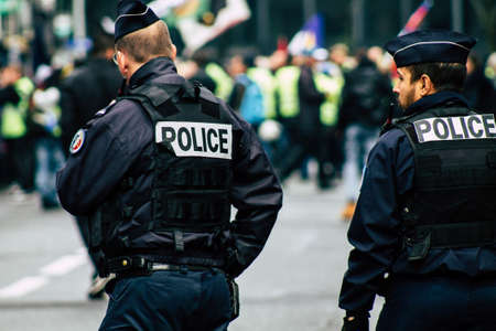 Paris France May 11, 2019 View of a riot squad of the French National Police in intervention during protests of the Yellow Jackets against the policy of President Macron in Paris on saturday afternoon Editorial