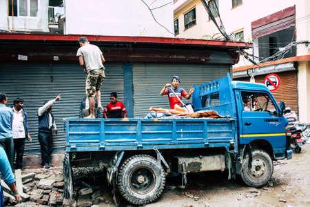 Kathmandu Nepal August 24, 2018 View of unknowns Nepali worker building a new house in Durbar street in Kathmandu in the morning