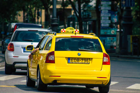 Budapest Hungary july 15, 2020 View of a traditional yellow Hungarian taxi for passengers driving through the streets of Budapest the capital and the most populous city of Hungary Editorial