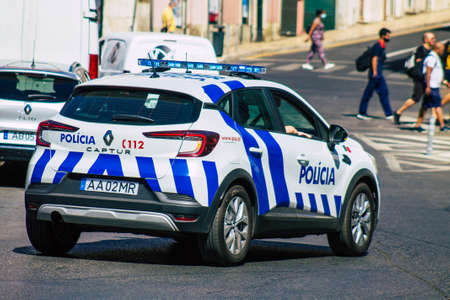 Lisbon Portugal july 24, 2020 View of a classic police car driving through the streets of Lisbon, the hilly coastal capital city of Portugal and one of the stunning oldest cities in Europe