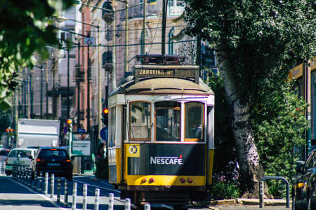 Lisbon Portugal july 24, 2020 View of a traditional old electric tram for passengers driving through the streets and part of the public transport system of Lisbon, the coastal capital city of Portugal