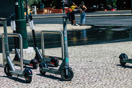 Lisbon Portugal july 25, 2020 View of an electric scooter parked in the streets of Lisbon, operating with a small utility internal combustion engine and a large deck in the center
