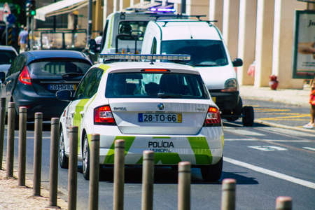 Lisbon Portugal july 25, 2020 View of a municipal police car driving through the streets of Lisbon, the hilly coastal capital city of Portugal and one of the stunning oldest cities in Europe