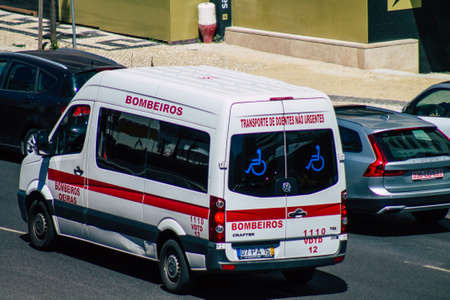 Lisbon Portugal july 25, 2020 View of a traditional ambulance rolling fast through the streets of Lisbon, the hilly coastal capital city of Portugal and one of the oldest cities in Europe