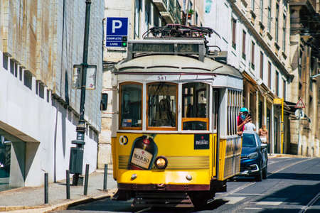 Lisbon Portugal july 26, 2020 View of a traditional old electric tram for passengers driving through the streets and part of the public transport system of Lisbon, the coastal capital city of Portugal