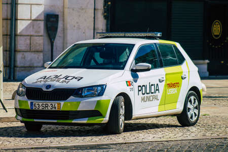 Lisbon Portugal August 01, 2020 View of a municipal police car driving through the streets of Lisbon, the hilly coastal capital city of Portugal and one of the stunning oldest cities in Europe Editorial