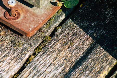 Closeup of a rustic wooden bridge spanning a pond in the french countryside in the fall Standard-Bild