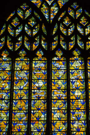 Reims France September 21, 2020 View of stained glass windows inside the Basilica of Saint-Remi, a medieval abbey church in Reims, a historical monument in the Grand Est region of France