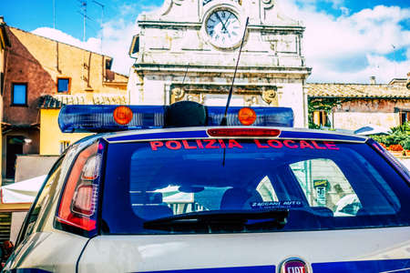 Closeup of an official police car patrolling the streets of the city center of the metropolitan area