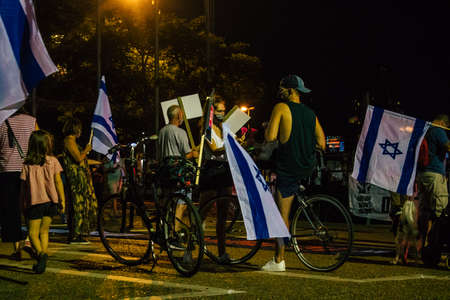 Tel Aviv Israel October 17, 2020 Unidentified people participating in a protest against government policy in Rabin Square opposite Tel Aviv City Hall despite the coronavirus outbreak and lockdown