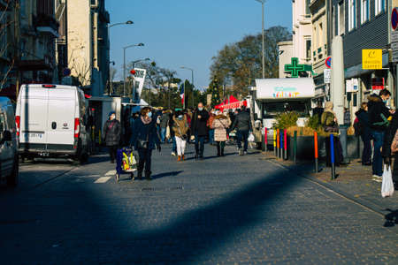 Reims France January 09, 2021 View of unidentified people with a face mask shopping at the market in downtown during Coronavirus outbreak and lockdown to enforce containment of the population