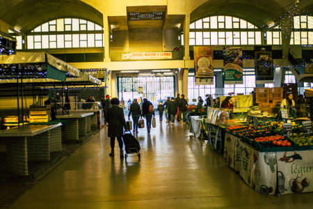Reims France January 09, 2021 View of unidentified people with face masks shopping in the covered market during the coronavirus epidemic and the lockdown to impose containment of the population