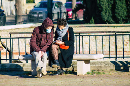 Reims France January 09, 2021 View of unidentified french people sitting in the streets of Reims to take a lunch because all the restaurants closed during the pandemic affecting France Editorial