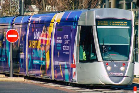 Reims France January 09, 2021 View of a modern electric tram for passengers driving through the streets and part of the public transport system of Reims in France