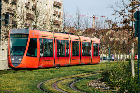 Reims France February 20, 2021 Modern electric tram for passengers rolling through the streets of Reims during the coronavirus outbreak hitting France
