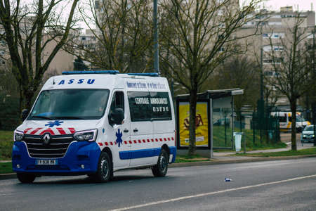 Reims France February 23, 2021 Ambulance driving through the streets of Reims during the coronavirus pandemic affecting France Editorial