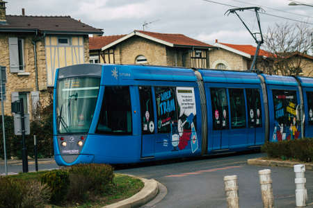 Reims France February 23, 2021 Modern electric tram for passengers rolling through the streets of Reims during the coronavirus outbreak hitting France Editorial