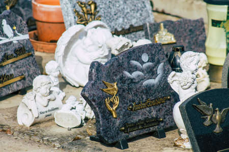 Reims France March 03, 2021 Religious objects of memories placed on the graves in the cemetery of the city of Reims during the coronavirus pandemic hitting France