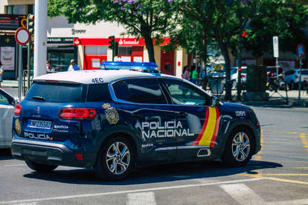 Seville Spain July 10, 2021 Police car patrolling in the streets of Seville, an emblematic city and the capital of the region of Andalusia, in the south of Spain