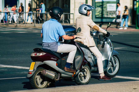 Seville Spain September 22, 2021 People rolling with a motorcycle in the streets of Seville, an emblematic city and the capital of the region of Andalusia, in the south of Spain Editorial