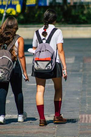 Seville Spain September 22, 2021 School girl walking in the street during the coronavirus outbreak hitting Spain, wearing a mask is not mandatory but most people wear it Editorial