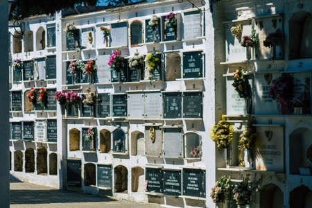 Seville Spain September 21, 2021 Typical graves in a Christian cemetery of the municipality of Carmona in Andalusia in southern Spain, the graves are made in the depth of a wall and richly decorated