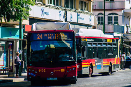 Seville Spain September 22, 2021 Bus driving through the streets of Seville during the coronavirus outbreak hitting Spain, wearing a mask is mandatory