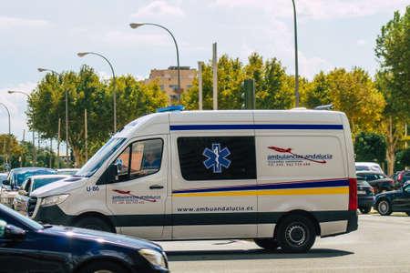 Seville Spain September 22, 2021 Ambulance driving through the streets of Seville during the coronavirus outbreak hitting Spain, wearing a mask is mandatory
