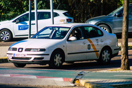 Seville Spain September 22, 2021 Taxi driving through the streets of Seville during the coronavirus outbreak hitting Spain, wearing a mask is mandatory
