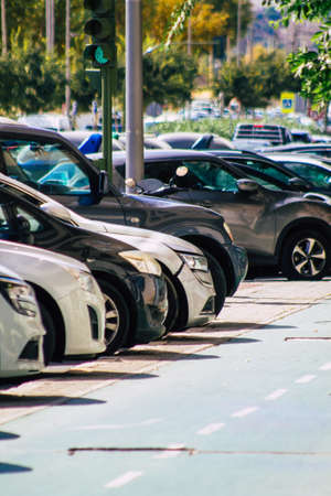 Seville Spain September 22, 2021 Cars parked in the streets of Seville, an emblematic city and the capital of the region of Andalusia, in the south of Spain