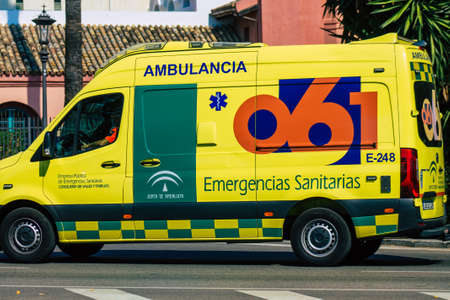 Seville Spain September 28, 2021 Ambulance driving through the streets of Seville during the coronavirus outbreak hitting Spain, wearing a mask is mandatory Editorial