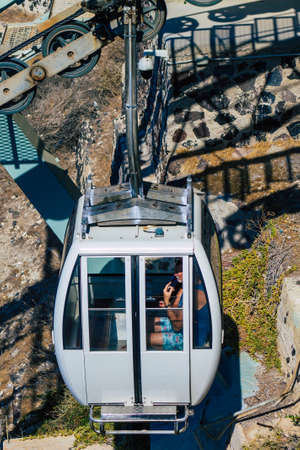 Santorini Island, Fira, Greece - October 08, 2021 Cable car provides a safe transport from the old port to Fira. Tourists also use it just to admire the amazing view of the stunning caldera