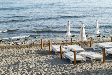 a selection of beach beds on the beach front in Marbella, Spain