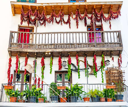 a selection of chillies and peppers being dried out on a balcony on a trip to Cazorla, Spain 스톡 콘텐츠
