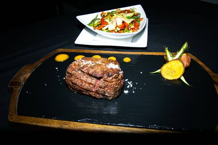 a prime Argentinian sirloin steak cooked to perfection served with some sautéed vegetables Stock Photo