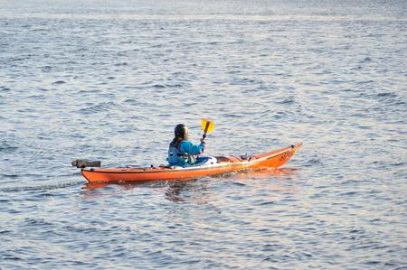 Galway Spanish Arch , Ireland June 2017,River Corrib , Girl Sailing a kayak.
