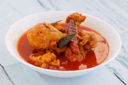 Spicy Reddish Chicken Curry or masala served in a bowl