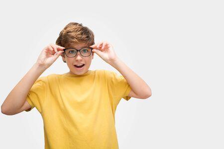 Boy puts on glasses