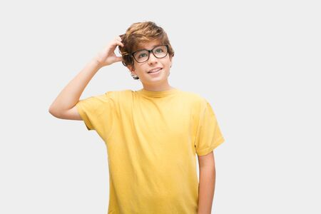 Boy with glasses looks for a way to ever study something he likes