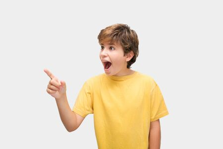 Funny child cheerfully points to the side