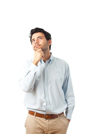 men standing: young man thinking on a white background Stock Photo