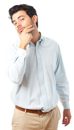 hand on the chin: young handsome man with hand on chin imagine gesture on a white background