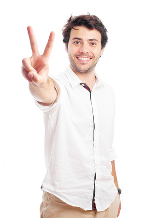 victory symbol: man doing victory symbol on a white background Stock Photo