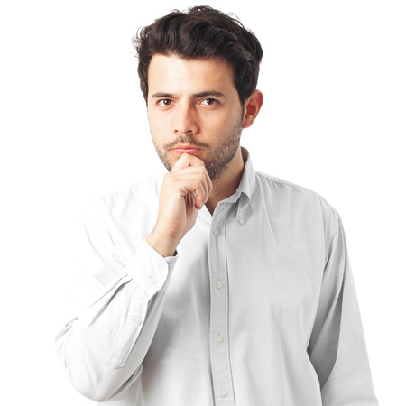young man thinking with a hand on chin on a white background