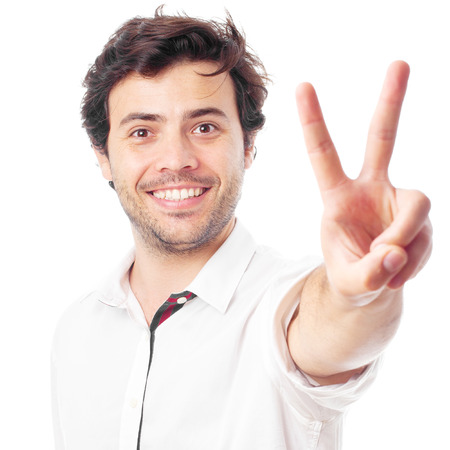 peace sign: man doing victory symbol on a white background Stock Photo