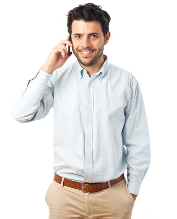 joyful businessman: young man listening on a phone on a white background